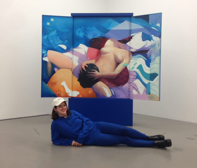 "Zohar Fraiman poses at Voix, MdBK, photo courtesy of artist. Painting: Zohar Fraiman, ""Donne-moi le code du bâtiment mon amour"""